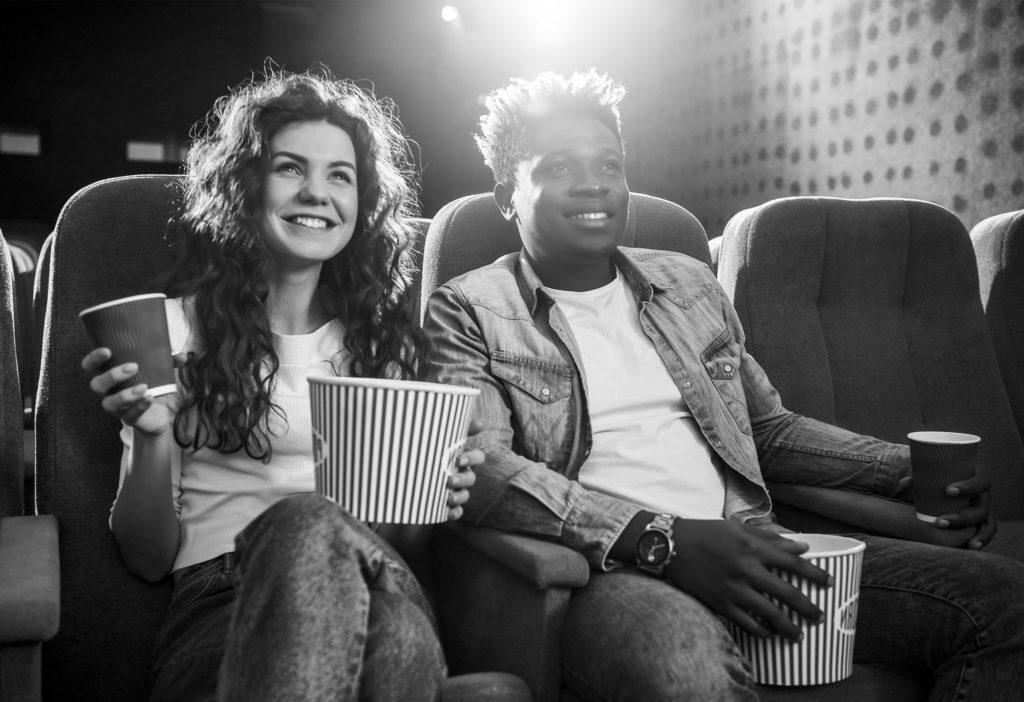 Couple having fun in the cinema