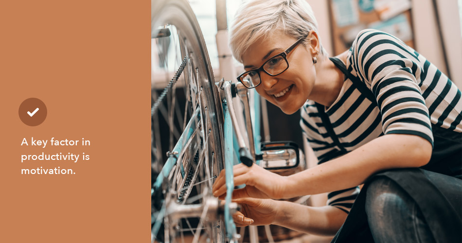 happy woman working in a bike shop